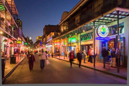 NEW ORLEANS, USA - CIRCA MARCH 2008: Crowds of people and neon lights at dusk circa March 2008 in New Orleans, USA. Tourism is the area's major source of income after Hurricane Katrina in 2005.