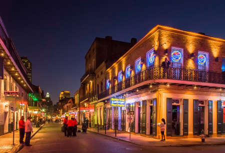 quarter: NEW ORLEANS, USA - CIRCA MARCH 2008: Crowds of people and neon lights at dusk circa March 2008 in New Orleans, USA. Tourism is the areas major source of income after Hurricane Katrina in 2005. Editorial