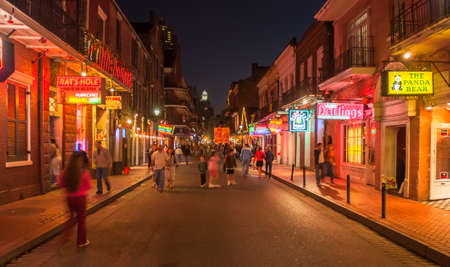 NEW ORLEANS, USA - CIRCA MARCH 2008: Crowds of people and neon lights at dusk circa March 2008 in New Orleans, USA. Tourism is the areas major source of income after Hurricane Katrina in 2005.