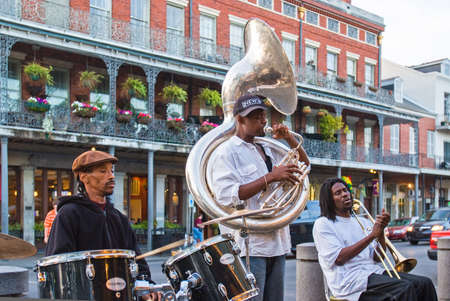 NEW ORLEANS, USA - CIRCA MARCH 2008: One of New Orleans' many jazz bands performs in front of the Cafe Du Monde circa March 2008 in New Orleans, USA. Tourism is the area's major source of income after Hurricane Katrina in 2005.