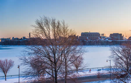 Boston's Charles River frozen with cross-country skiier photo