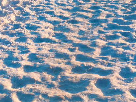 Footprints worn into the snow on a winter day photo