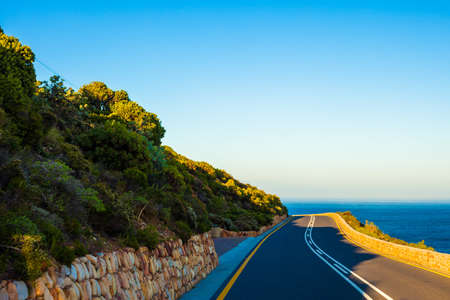 curving: Curving road near the sea, Cape Town, South Africa Stock Photo