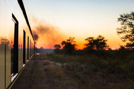 Vintage train going off into the sunset Stock Photo - 16619044