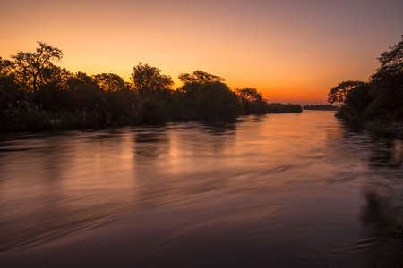 The Zambezi River at dusk, seen from Zambia photo