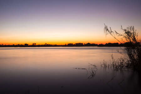 The Zambezi River at dusk, seen from Zambia