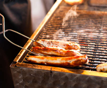 German sausages being grilled over coal outdoors