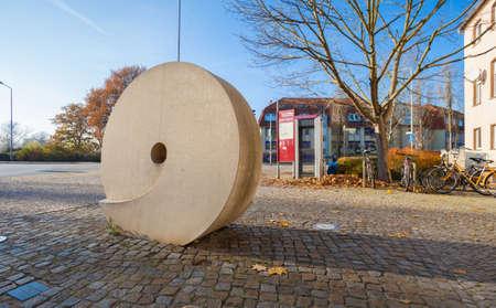 millstone: Traditional millstone on display in public, Fuerstenwalde, Brandenburg Stock Photo