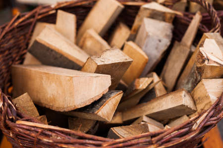 log basket: Firewood in a basket for heating a traditional oven