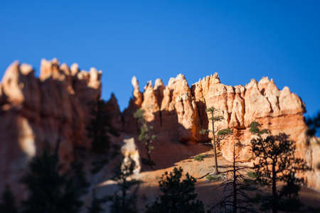 tilt view: Tilt shift effect view of tourist outlook point and railing in Bryce Canyon, Utah Stock Photo
