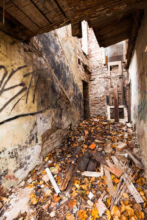 decaying: Interior ruins of an abandoned brick building, slowly decaying