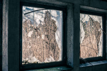 abandoned warehouse: Abandoned warehouse with broken windows on a sunny day