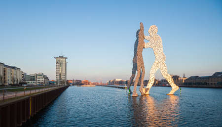 River Spree and Molecule Man  Men statue, Berlin