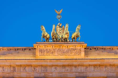 quadriga: Quadriga detail view. Berlins Brandenburg Gate (Brandenburger Tor) at dusk Stock Photo