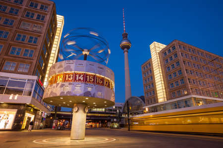 Speeding tram at Berlin's Alexanderplatz, Weltzeituhr (World Time Clock), and TV Tower