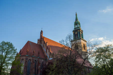 st german: The Marienkirche (St Marys Church) at Berlin Alexanderplatz in afternoon Stock Photo
