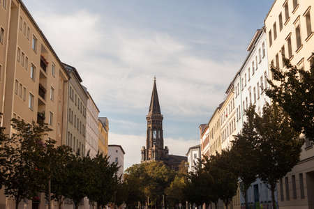 townhomes: Apartments and the Zionskirche in the afternoon near Kastanienallee, Prenzlauer Berg, Berlin Stock Photo