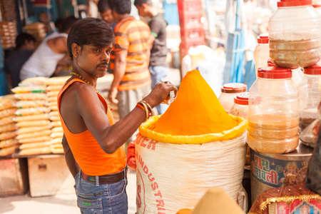 wares: KOLKATA, INDIA - 22 Oct 2016: A spice vendor prepares his wares on October 22, 2016 in Kolkata (Calcutta), India