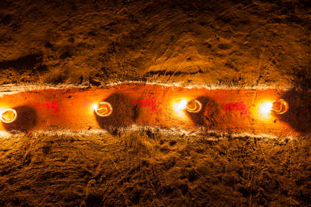 Oil lamps on a painted red pathway for Lakshmi Puja during the Diwali  Tihar holiday in Nepal