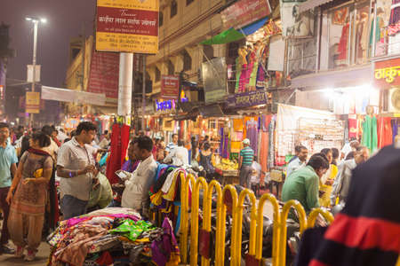 haggling: VARANASI, INDIA - 24 Oct 2016: Merchants and customers at the night market near Dasaswamedh Ghat on October 24, 2016 in Varanasi, India