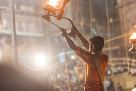 VARANASI, INDIA - 24 Oct 2016: Waving Kapoor lamps. Crowds watch as priests perform the Ganga Aarti ceremony at Dasaswamedh Ghat on October 24, 2016 in Varanasi, India Editorial