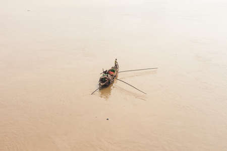west river: A traditional fishing boat deploys a net in the Hooghly River in Kolkata (Calcutta), West Bengal, India