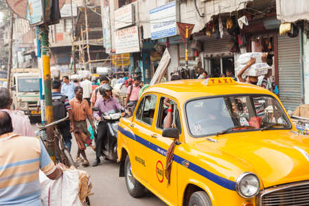 crowded street: KOLKATA, INDIA - 22 Oct 2016: Taxi on a crowded street on October 22, 2016 in Kolkata (Calcutta), India