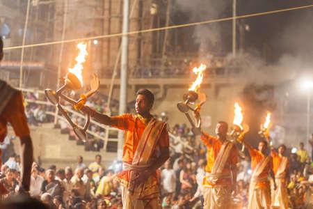 benares: VARANASI, INDIA - 24 Oct 2016: Waving Kapoor lamps. Crowds watch as priests perform the Ganga Aarti ceremony at Dasaswamedh Ghat on October 24, 2016 in Varanasi, India Editorial