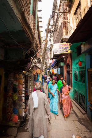 benares: VARANASI, INDIA - 25 Oct 2016: Passerby walk through the alleyways on October 25, 2016 in Varanasi, India Editorial