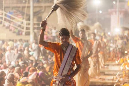 benares: VARANASI, INDIA - 24 Oct 2016: Waving the yak-tail fan. Crowds watch as priests perform the Ganga Aarti ceremony at Dasaswamedh Ghat on October 24, 2016 in Varanasi, India