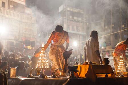 benares: VARANASI, INDIA - 24 Oct 2016: Crowds watch as priests perform the Ganga Aarti ceremony at Dasaswamedh Ghat on October 24, 2016 in Varanasi, India