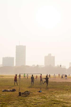 kolkata: KOLKATA, INDIA - 22 Oct 2016: Boys play soccer on the Maidan on October 22, 2016 in Kolkata (Calcutta), India Editorial