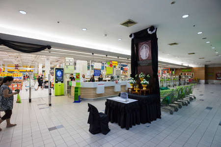 recently: BANGKOK - 19 Oct 2016: Memorial to the recently deceased King Bhumibol Adulyadej at Big C Extra grocery store on October 19, 2016 in Bangkok