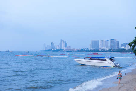 speedboats: Speedboat and woman, Pattaya Beach, Thailand Stock Photo