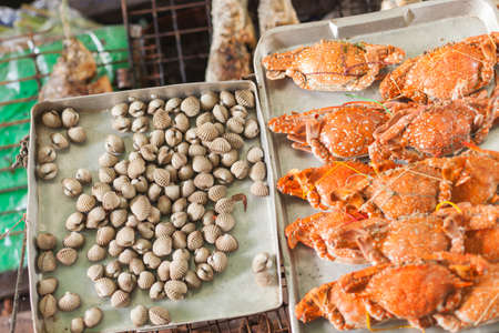 fish vendor: Fresh clams and crabs at a Thai market