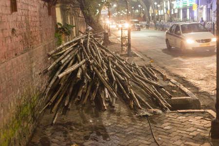 Bamboo poles on the sidewalk in Kolkata (Calcutta), India