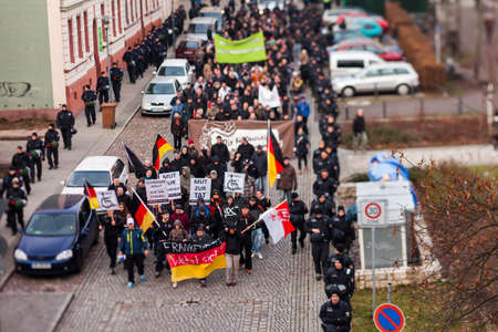 FRANKFURT (ODER), GERMANY - 17 January 2015: Right-wing demonstrators march against immigration and refugees, 15 January 2015 in Frankfurt (Oder), Germany
