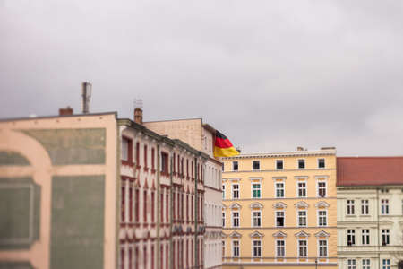 rightwing: A German flag flies from the roof of an apartment building in Frankfurt (Oder) ahead of a right-wing protest