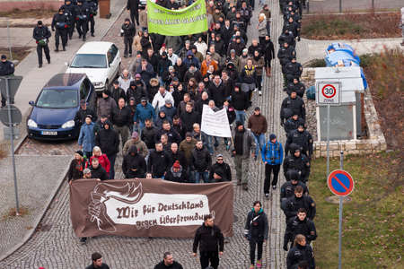 rightwing: FRANKFURT (ODER), GERMANY - 17 January 2015: Right-wing demonstrators march against immigration and refugees, 15 January 2015 in Frankfurt (Oder), Germany