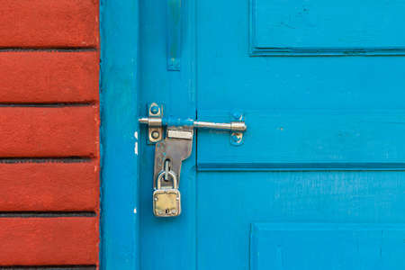 padlocked: Padlocked door with bolt on the Indian subcontinent