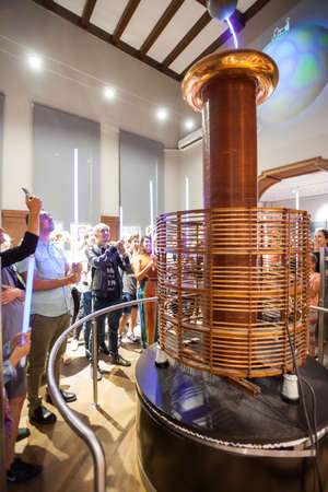 BELGRADE, Serbia - 5 Sept: Tourists take part in a Tesla Coil demonstration at the Nikola Tesla Museum in Belgrade on 5 Sept 2017.