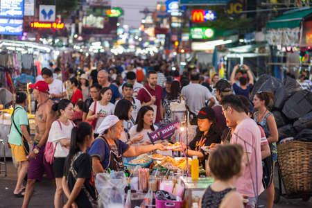 BANGKOK, MARCH 11: Tourists haggle with a Pad Thai vendor on Bangkoks Khao San Road on March 11.