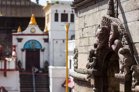Detail of a minor temple with the main temple in the background, Pashupatinath, Kathmandu, Nepal Stock Photo