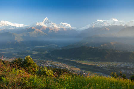 Machapuchare (Fish Tail) and Annapurna Range mountains in the Himalayas, Nepal Stock Photo