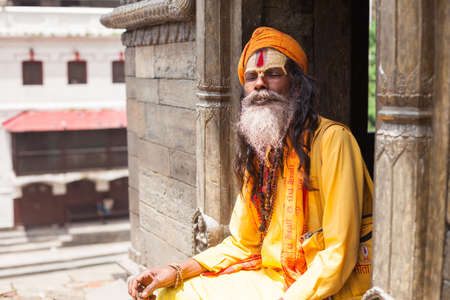 A Sadhu sits in one of the temples at the Pashupatinath temple complex, Kathmandu, Nepal Editorial