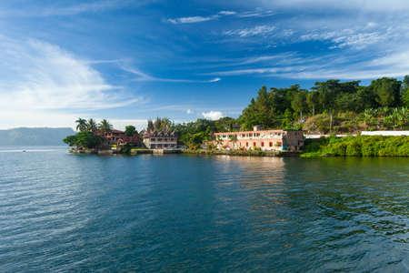 Houses and hotels on Lake Toba at Tuk Tuk peninsula, Samosir Island, Sumatra, Indonesia