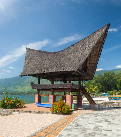 Traditional Batak roof architecture in Tuk Tuk on Samosir Island, Lake Toba, , Sumatra, Indonesia Editoriali