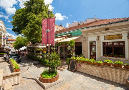 BELGRADE, SERBIA – JULY 07: Visitors enjoy cafes in Skadarlija, Belgrade's bohemian quarter on 07 July 2019 in Belgrade, Serbia.