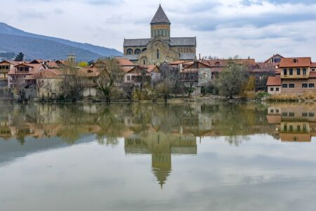 View of Svetitskhoveli cathedral over Mtkvari (Kura) river at early springtime