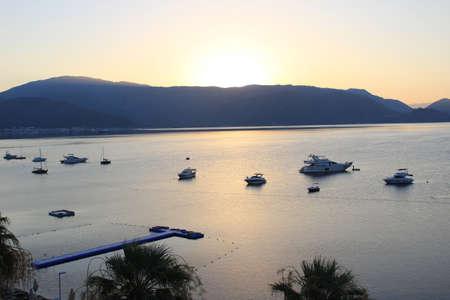 Boat anchored at sunset